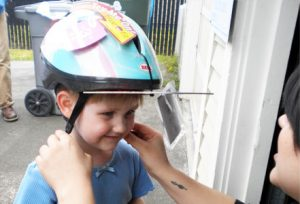 child-utilizing-helmet-to-prevent-brain-injury